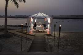 Dine under the stars at Al Raha Beach Hotel